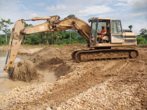 A bulldozer Clearing Vegetation for Mining